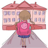 Little girl with big school bag standing towards school building Royalty Free Stock Photo