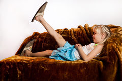 Little Girl And Big Shoes Stock Photography