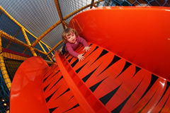 Little girl on a big slide Stock Image