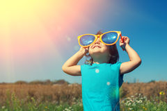 Little girl with big sunglasses Stock Photography