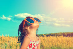 Little girl with big sunglasses Royalty Free Stock Images