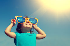 Little girl with big sunglasses royalty free stock image
