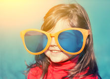 Little girl with big sunglasses Royalty Free Stock Photos