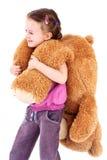 Little girl with big teddie bear Stock Image