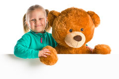 Little girl with big teddy bear Stock Photos