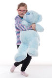 Little girl with big teddy bear Stock Photos