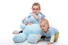 Little girl with big teddy bear Royalty Free Stock Image