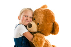 Little girl with big teddy bear Royalty Free Stock Images