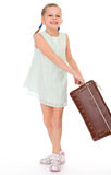 Little girl with a big and very old suitcase. Royalty Free Stock Photography