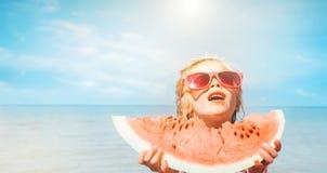 Little girl with big watermelon segment funny seside portrait stock image