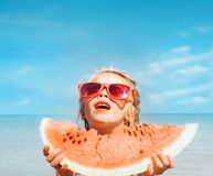 Little girl with big watermelon segment funny seside portrait stock images