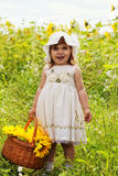Little girl with a big wattled basket Royalty Free Stock Images
