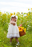 Little girl with a big wattled basket Royalty Free Stock Image