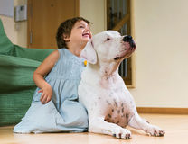 Little girl with big white dog Royalty Free Stock Photos