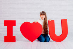 Little girl with a big  word I love you Royalty Free Stock Photo