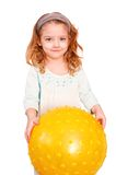 Little girl and big yellow ball Stock Image