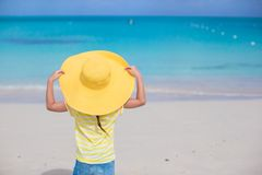 Little girl in a big yellow straw hat on white Stock Photo