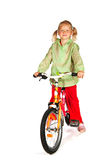Little girl with bike Stock Photography