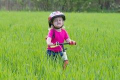 Little girl on bike Stock Images