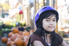 Little girl with bike helmet on bicycle Stock Image
