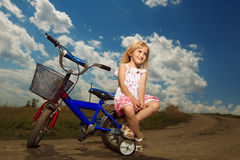 Little girl with bike Stock Photography