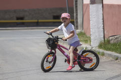 Little girl on bike Royalty Free Stock Image