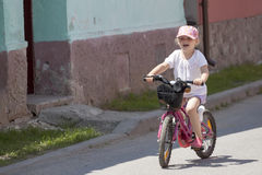 Little girl on bike Stock Photography
