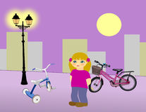 Little Girl with Bikes Royalty Free Stock Image