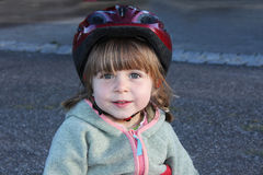 Little girl with biking helmet Royalty Free Stock Photo