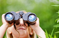 Little girl with binocular Royalty Free Stock Photo
