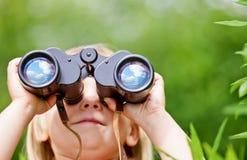 Little girl with binocular royalty free stock photo