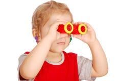 Little girl with binoculars Royalty Free Stock Photo