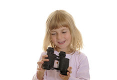 Little girl with binoculars Stock Images