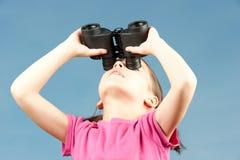 Little girl with binoculars Stock Photos