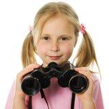Little girl with binoculars Royalty Free Stock Photography
