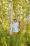 Little girl among birches. In Russia Stock Photo