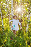 Little girl among birches. In Russia Royalty Free Stock Photos