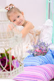 Little girl with birdcage in home interior royalty free stock image