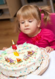 Little Girl and Birthday Cake. Cute little girl 2-year old getting ready to blow out the candle on her birthday cake stock photos
