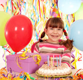 Little girl with birthday cake and gift Royalty Free Stock Photography