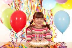 Little girl with birthday cake Stock Photos