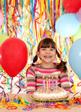 Little girl with birthday cake party Stock Photo