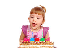 Little girl with birthday candles and cake Stock Photos