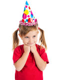 Little girl in birthday cap. Funny girl in birthday cap isolated on white Royalty Free Stock Photos