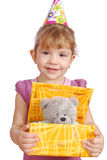 Little girl with birthday gift Stock Image
