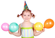 Little girl with birthday hat and balloons Royalty Free Stock Photography