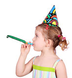 Little girl with birthday hat and trumpet party Stock Photo