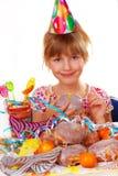 Little girl on birthday party stock photo