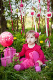 Little girl with birthday presents Stock Images
