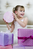 Little girl with birthday presents Royalty Free Stock Photos